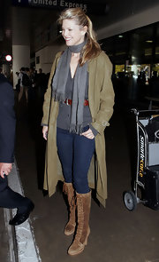Arriving at LAX airport Christie shows off these aweosme lace up brown suede boots for a warm winter look.
