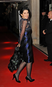 Sadie Frost added girlish charm to her red carpet look with sweet black patent pumps with darling ankle straps.