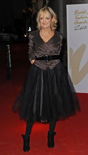 Twiggy wore a collared wrap top with a thick belt and frilly tulle skirt for the British Fashion Awards.