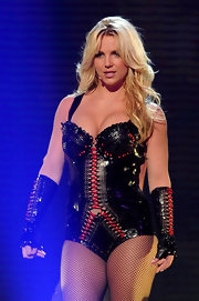 Britney Spears looks like a dominatrix on stage in a laced leather bodysuit.