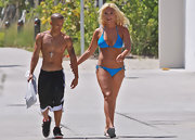 Brooke Hogan flaunts her beach body in this bright blue halter string bikini.