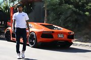 Chris Brown tucked his skinny jeans into a pair of statement basketball sneakers as he exited his brand new Lamborghini.