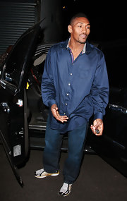 Metta World Peace went all-blue with his long-sleeved button-down shirt and jeans.