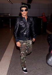 Bruno Mars opted for a cool black bomber while traveling to LA.