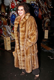 Claudia Cardinale looked positively decadent in this floor-length fur coat.