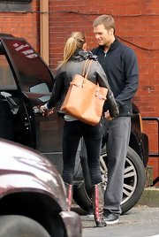 6000d62fa1c7 Gisele Bundchen enjoyed a moment with husband Tom Brady rocking a leather  jacket and a tan