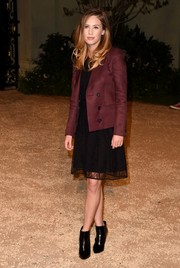 Dylan Penn was all business in a burgundy Burberry Prorsum blazer layered over a lace LBD during the London in Los Angeles show.