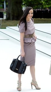 Victoria Pendleton chose a classic black tote bag to pair with her trendy dress.