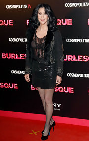 Cher wears a sheer black bra beneath her sheer blouse for this 'Burlesque' style.