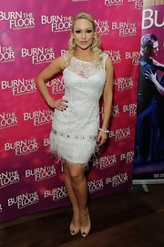 Kristina Rihanoff opted for a white lace cocktail dress with feathered hem for her red carpet look at 'Burn the Floor.'