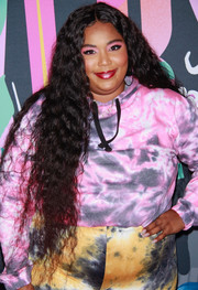Lizzo rocked hip-length curls at the 2019 Rule Breakers Festival.