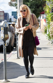 Busy Philipps styled her outfit with a pair of black tassel loafers.