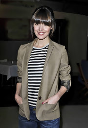 Rose Byrne wore this ecru blazer with a nautical striped top.