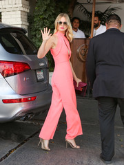 January Jones hovered between sweet and sexy in a bubblegum-pink Cushnie Et Ochs jumpsuit with a keyhole cutout during the CFDA/Vogue Fashion Fund show.