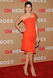 Marisa wears a bright and daring color to the Heroes Event in this chic silhouette.