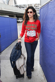 Camila Alves broke out the Christmas sweater for a flight.