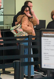 Camila Cabello was spotted at LAX carrying a chic Gucci backpack.