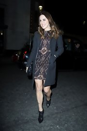 Mel C's studded black ankle boots, print dress, and coat were an ultra-stylish combination.