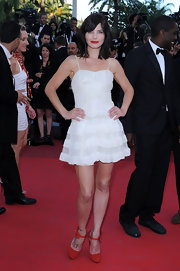 Delphine Chaneac was spotted at the Cannes 2011 premiere of 'The Artist' in her spaghetti strapped ruffled mini dress.