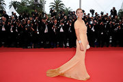 Clotilde looked cheerfully elegant at the Cannes Film Festival in a beaded tangerine evening gown.