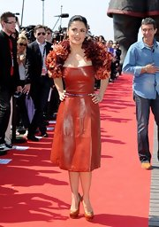 Salma added a flirty element to her leather dress with a floral shrug for the Cannes Film Festival.