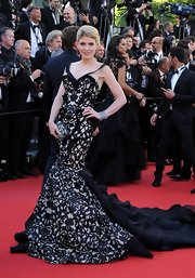 Hofit Golan chose this black lace and ruffle mermaid gown for her red carpet look at the premiere of 'Blood Ties.'