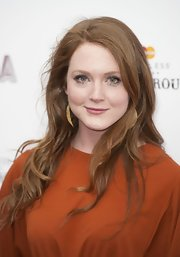 Olivia Hallinan wore her ultra-long locks styled in subtle wind-swept waves.
