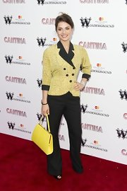 This bold yellow leather handbag was ladylike and tied Charlotte Riley's whole outfit together.