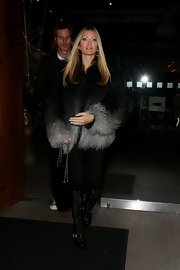 Caprice Bourret opted for a glamorous look with an ombre fur coat while out for dinner.