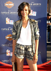 Zoe Saldana opted for a Resort '12 look in a star print bomber jacket with gold epaulets for the 'Captain America' premiere. Zoe wore her hair back in a side-swept chignon to add romance to this edgy look.