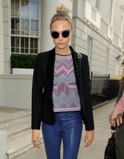 Cara Delevingne looked a little broody wearing a pair of round dark sunnies while out in London.