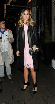 Suki Waterhouse layered a black leather coat over a pink lace dress for a night out in London.