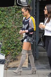 Cara Santana was spotted out carrying a black python shoulder bag.