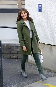 An olive green wool coat gave Carol Vorderman a chic and classic daytime look.