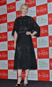 Cate Blanchett looked as classy as ever in a black mixed-lace dress by Givenchy while attending the 'Carol' stage greeting in Tokyo.