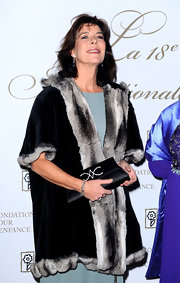 Princess Caroline looked regal carrying a black satin clutch, embellished with a crystal design.