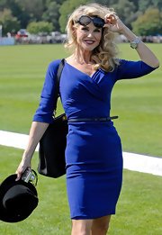 Christie Brinkley continues to blow us away with her age-defying figure and relentless beauty. The supermodel attended the Cartier polo event in a royal blue faux-wrap cocktail dress. Black hollywood shades, a skinny belt and perfect blond curls completed her day-chic style.