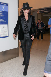 Catherine Zeta-Jones was a stylish standout at LAX in a black velvet and satin blazer.