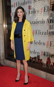 Catherine Zeta Jones wore a retro yellow wool coat with cropped sleeves and shiny black buttons.
