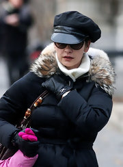 Catherine wears a leather billed newsboy cap for this winter style.