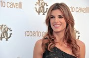 Elisabetta Canalis looked fabulous at the opening of a new Roberto Cavalli boutique. To recreate her sexy look, set hair in hot rollers for more hold or use a large-barreled curling iron. Tousle ends lightly and spritz with a medium-hold hairspray to finish.
