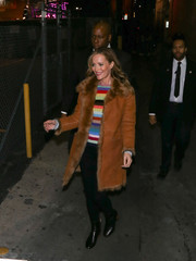 Leslie Mann arrived for her 'Jimmy Kimmel Live' appearance wearing a fur-trimmed tan suede coat over a rainbow-striped shirt.