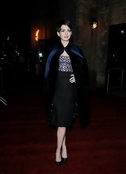 Anne matched the drama of the night with a luxe blue velvet cape.