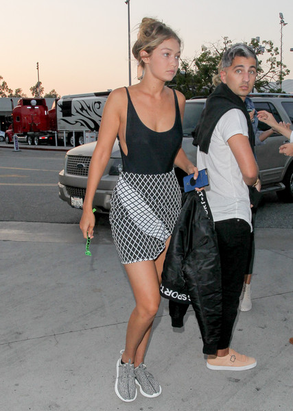 Gigi Hadid headed to Taylor Swift's concert rocking a sexy black one-piece by Sahara Ray.