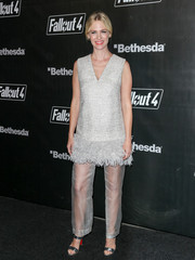 January Jones got all frilled up in a silver tweed and feather top by Lela Rose for the 'Fallout 4' launch party.