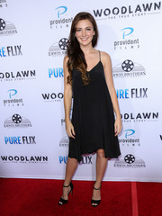 Samantha Munro hit the 'Woodlawn' premiere in a classic black slip dress with matching heels.