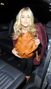 Mollie King left the Chain of Hope Ball carrying an orange leather backpack.