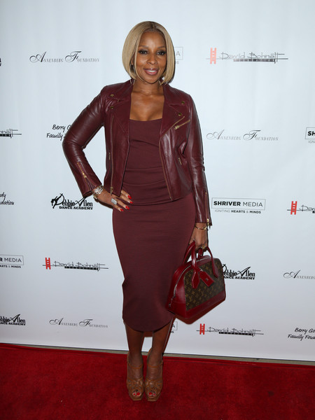 Mary J. Blige topped off her monochromatic look with a Louis Vuitton bowler bag.
