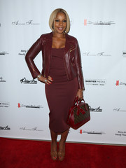 Mary J. Blige layered a burgundy leather biker jacket over a matching dress for the U.S. premiere of Debbie Allen's 'Freeze Frame.'