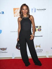 Holly Robinson Peete worked the red carpet in a sleek black halterneck jumpsuit at the Ebony Power 100 70th anniversary gala.